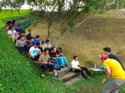 Children sitting on hill